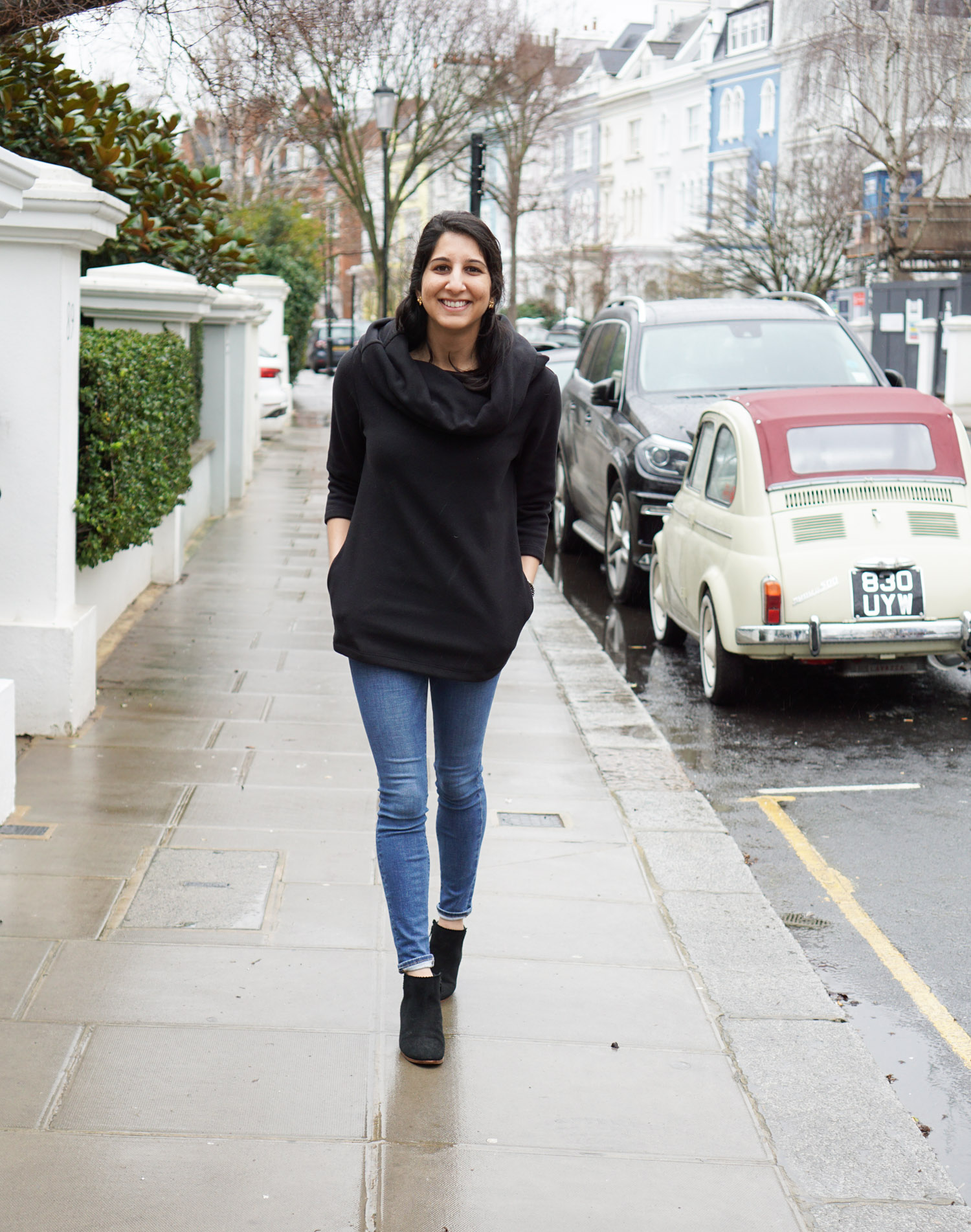 Dudley Stephens review featured by US fashion blog, Monica Dutia: image of a woman wearing a Dudley Stephens fleece, FRAME jeans, Jack Rogers booties, Gigi New York bag and Sweet and Spark earrings